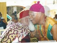 Igwe Kenneth Onyeneke Orizu III greeting an ozo title